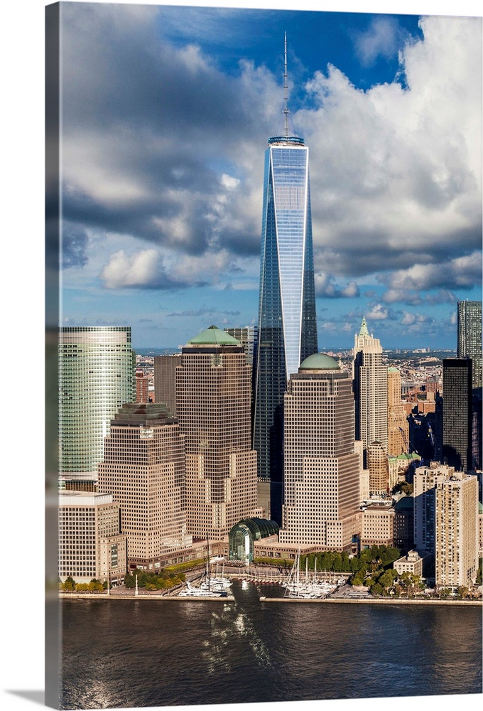 Large Solid-Faced Canvas Print Wall Art Print 24 x 36 entitled New York City, Manhattan, Freedom Tower in the Financial Di... Solid-Faced Canvas Print entitled New York City, Manhattan, Freedom Tower in the Financial District.  USA, New York City, Manhattan, Lower Manhattan, Freedom Tower in the Financial District.  Multiple sizes available.  Primary colors within this image include Dark Yellow, Black, Silver, Royal Blue.  Made in the USA.  All products come with a 365 day workmanship guarantee.  Inks used are latex-based and designed to last.  Archival inks prevent fading and preserve as much fine detail as possible with no over-saturation or color shifting.  Canvas is handcrafted and made-to-order in the United States using high quality artist-grade canvas.