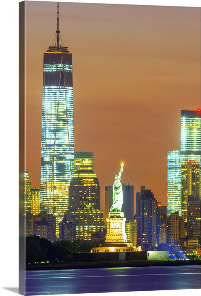 Large Solid-Faced Canvas Print Wall Art Print 24 x 36 entitled New York City, Manhattan, Liberty Island, Statue of Liberty Solid-Faced Canvas Print entitled New York City, Manhattan, Liberty Island, Statue of Liberty.  USA, New York City, Manhattan, Lower Manhattan, Liberty Island, Statue of Liberty, Lower Manhattan with Freedom Tower and Statue of Liberty at sunset.  Multiple sizes available.  Primary colors within this image include Brown, Light Yellow, Light Green, White.  Made in USA.  Satisfaction guaranteed.  Inks used are latex-based and designed to last.  Canvas depth is 1.25 and includes a finished backing with pre-installed hanging hardware.  Canvas is handcrafted and made-to-order in the United States using high quality artist-grade canvas.