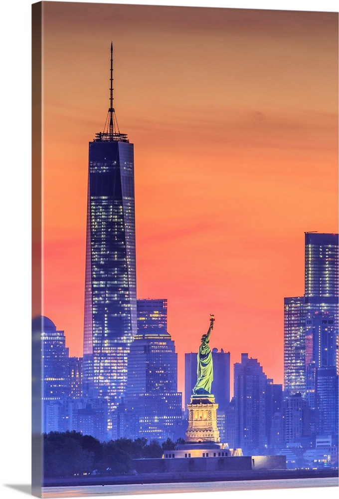 Large Solid-Faced Canvas Print Wall Art Print 24 x 36 entitled New York City, Manhattan, Liberty Island, Statue of Liberty Solid-Faced Canvas Print entitled New York City, Manhattan, Liberty Island, Statue of Liberty.  USA, New York City, Manhattan, Lower Manhattan, Liberty Island, Statue of Liberty, Lower Manhattan with Freedom Tower and Statue of Liberty at sunset.  Multiple sizes available.  Primary colors within this image include Pink, Gray, White, Muted Blue.  Made in USA.  All products come with a 365 day workmanship guarantee.  Archival-quality UV-resistant inks.  Archival inks prevent fading and preserve as much fine detail as possible with no over-saturation or color shifting.  Canvas is handcrafted and made-to-order in the United States using high quality artist-grade canvas.