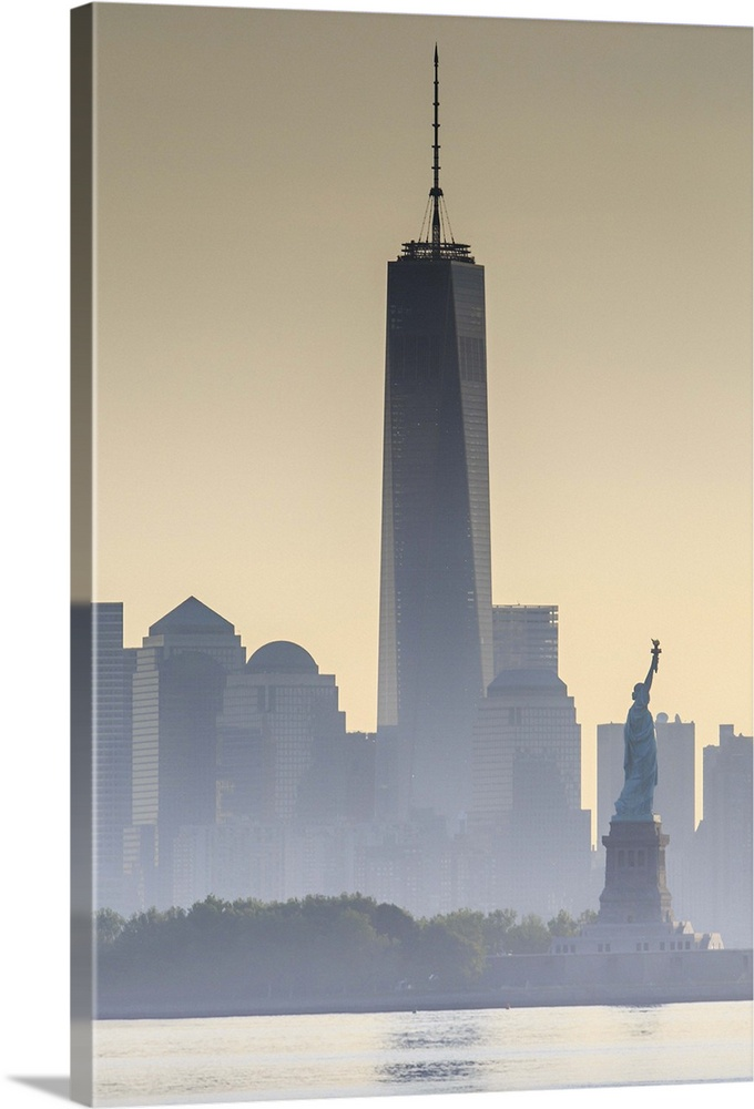 Large Solid-Faced Canvas Print Wall Art Print 24 x 36 entitled New York City, Manhattan, Liberty Island, Statue of Liberty Solid-Faced Canvas Print entitled New York City, Manhattan, Liberty Island, Statue of Liberty.  USA, New York City, Manhattan, Lower Manhattan, Liberty Island, Statue of Liberty, Lower Manhattan with Freedom Tower and Statue of Liberty at sunset.  Multiple sizes available.  Primary colors within this image include Black, Gray, Silver.  Made in the USA.  Satisfaction guaranteed.  Inks used are latex-based and designed to last.  Canvas depth is 1.25 and includes a finished backing with pre-installed hanging hardware.  Featuring a proprietary design, our canvases produce the tightest corners without any bubbles, ripples, or bumps and will not warp or sag over time.