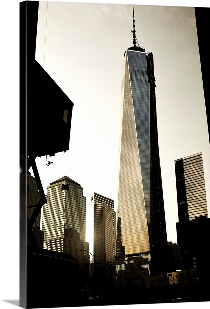 Large Solid-Faced Canvas Print Wall Art Print 24 x 36 entitled New York City, Manhattan, Lower Manhattan, One World Trade ... Solid-Faced Canvas Print entitled New York City, Manhattan, Lower Manhattan, One World Trade Center, Freedom Tower.  USA, New York City, Manhattan, Lower Manhattan, One World Trade Center, Freedom Tower.  Multiple sizes available.  Primary colors within this image include Black, Gray, White.  Made in the USA.  All products come with a 365 day workmanship guarantee.  Inks used are latex-based and designed to last.  Featuring a proprietary design, our canvases produce the tightest corners without any bubbles, ripples, or bumps and will not warp or sag over time.  Archival inks prevent fading and preserve as much fine detail as possible with no over-saturation or color shifting.