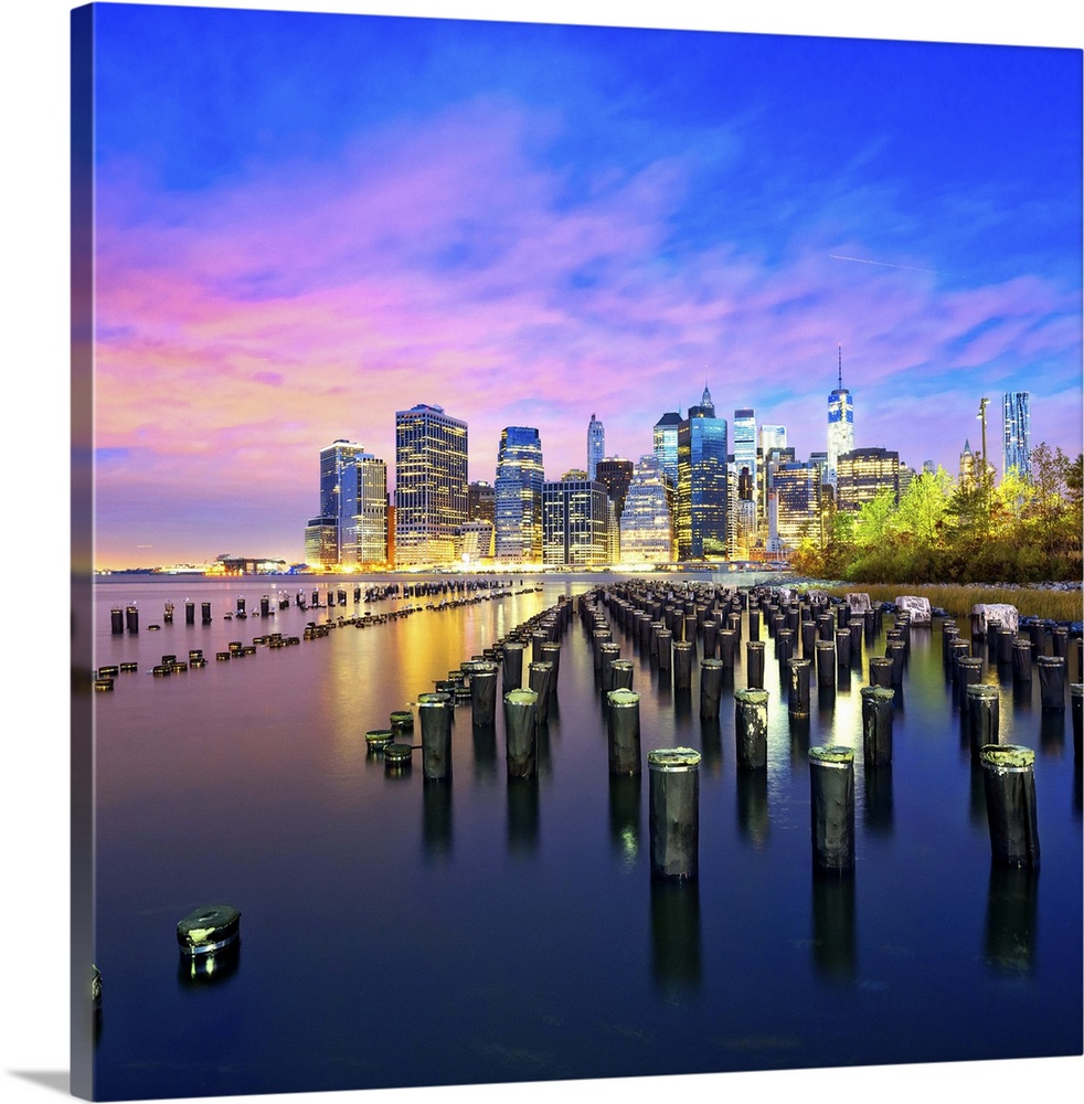 Large Solid-Faced Canvas Print Wall Art Print 24 x 24 entitled New York City, Manhattan, Lower Manhattan, Skyline with Fre... Solid-Faced Canvas Print entitled New York City, Manhattan, Lower Manhattan, Skyline with Freedom Tower at dawn.  USA, New York City, Manhattan, Lower Manhattan, Skyline with Freedom Tower at dawn, view from Brooklyn Bridge Park.  Multiple sizes available.  Primary colors within this image include Blue, Lilac, Black, Pale Blue.  Made in the USA.  All products come with a 365 day workmanship guarantee.  Archival-quality UV-resistant inks.  Canvas depth is 1.25 and includes a finished backing with pre-installed hanging hardware.  Canvas is handcrafted and made-to-order in the United States using high quality artist-grade canvas.