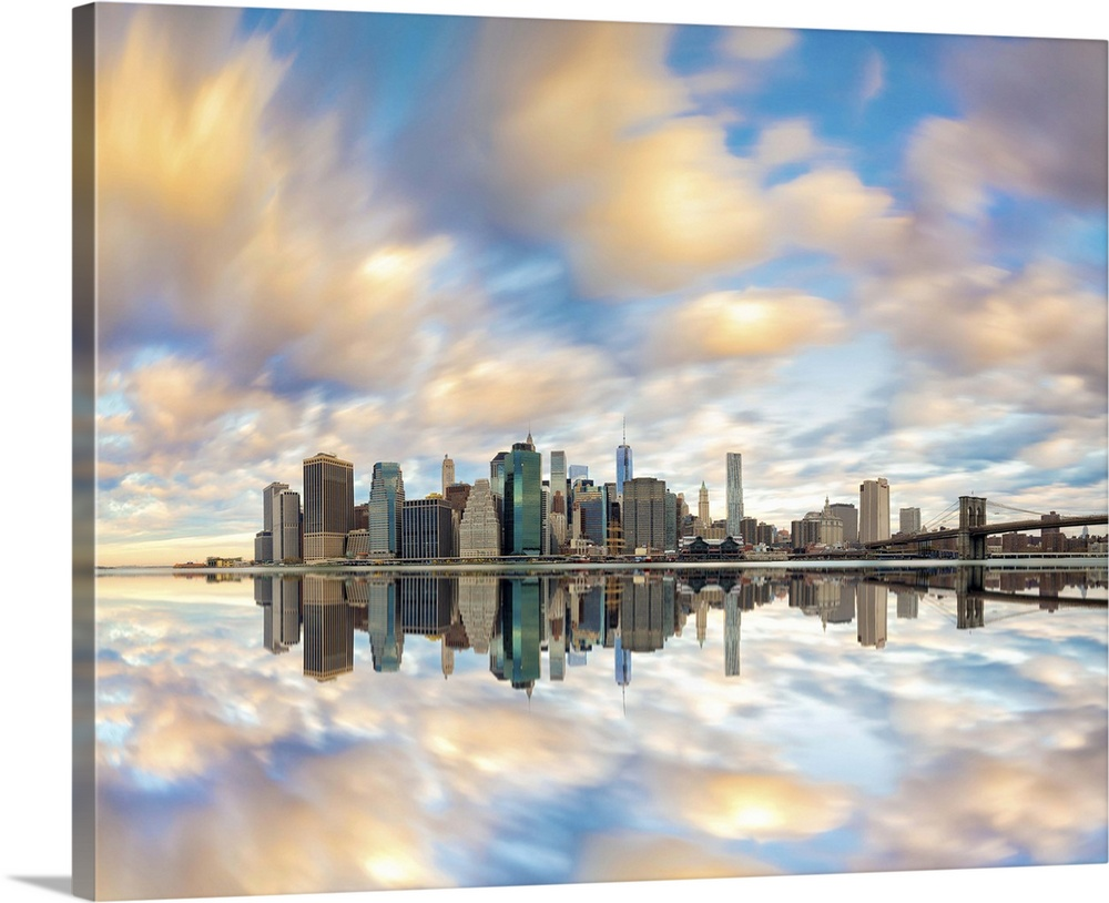 Large Solid-Faced Canvas Print Wall Art Print 45 x 36 entitled New York City, Manhattan, Lower Manhattan, Skyline with Fre... Solid-Faced Canvas Print entitled New York City, Manhattan, Lower Manhattan, Skyline with Freedom Tower at dawn.  USA, New York City, Manhattan, Lower Manhattan, Skyline with Freedom Tower at dawn, view from Brooklyn Bridge Park.  Multiple sizes available.  Primary colors within this image include White, Dark Forest Green, Royal Blue.  Made in USA.  Satisfaction guaranteed.  Archival-quality UV-resistant inks.  Archival inks prevent fading and preserve as much fine detail as possible with no over-saturation or color shifting.  Featuring a proprietary design, our canvases produce the tightest corners without any bubbles, ripples, or bumps and will not warp or sag over time.