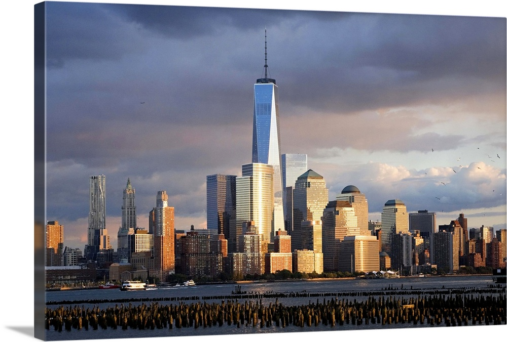Large Solid-Faced Canvas Print Wall Art Print 36 x 24 entitled New York City, Manhattan, Manhattan Financial District Solid-Faced Canvas Print entitled New York City, Manhattan, Manhattan Financial District.  USA, New York City, Manhattan, Lower Manhattan, One World Trade Center, Freedom Tower, Manhattan Financial District.  Multiple sizes available.  Primary colors within this image include Brown, Black, White, Gray Blue.  Made in USA.  All products come with a 365 day workmanship guarantee.  Inks used are latex-based and designed to last.  Archival inks prevent fading and preserve as much fine detail as possible with no over-saturation or color shifting.  Featuring a proprietary design, our canvases produce the tightest corners without any bubbles, ripples, or bumps and will not warp or sag over time.