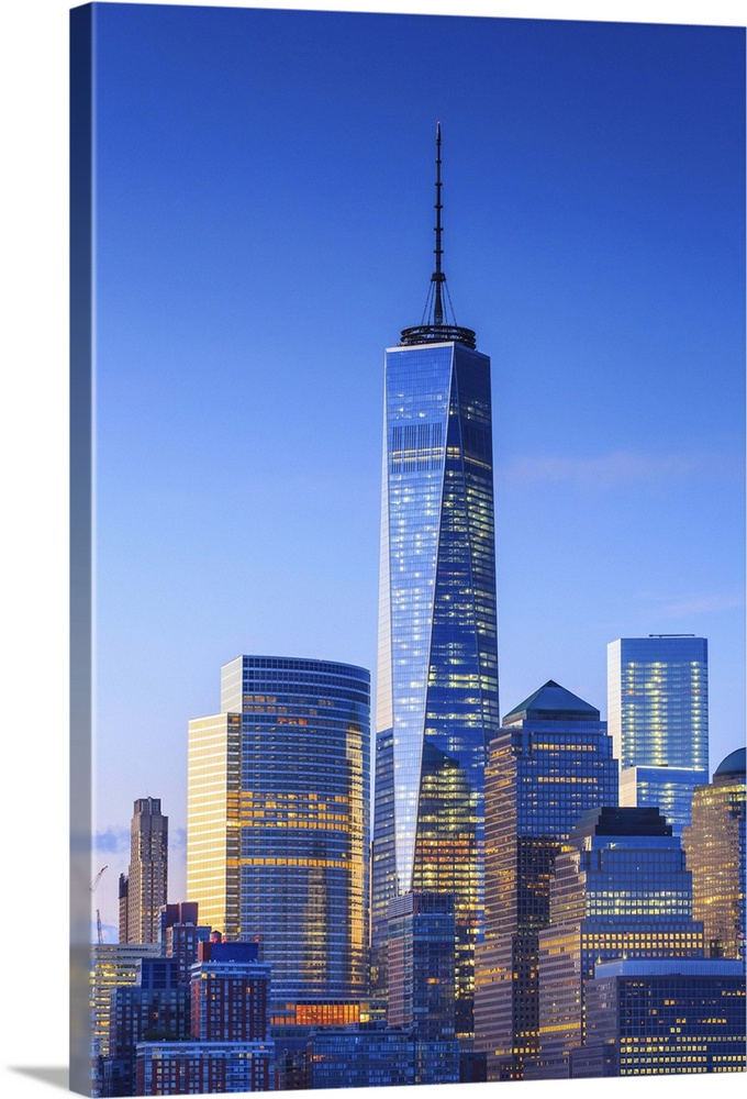 Large Solid-Faced Canvas Print Wall Art Print 24 x 36 entitled New York City, Manhattan, One World Trade Center Solid-Faced Canvas Print entitled New York City, Manhattan, One World Trade Center.  USA, New York City, Manhattan, Lower Manhattan, One World Trade Center, Freedom Tower, Lower Manhattan buildings illuminated at night.  Multiple sizes available.  Primary colors within this image include Dark Blue, Sky Blue, Gray, White.  Made in the USA.  Satisfaction guaranteed.  Inks used are latex-based and designed to last.  Canvas depth is 1.25 and includes a finished backing with pre-installed hanging hardware.  Archival inks prevent fading and preserve as much fine detail as possible with no over-saturation or color shifting.