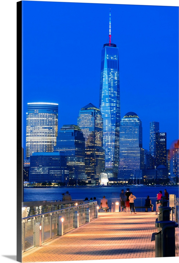 Large Solid-Faced Canvas Print Wall Art Print 24 x 36 entitled New York City, Manhattan, One World Trade Center, Freedom T... Solid-Faced Canvas Print entitled New York City, Manhattan, One World Trade Center, Freedom Tower, City skyline at dusk.  USA, New York City, Manhattan, Lower Manhattan, One World Trade Center, Freedom Tower, City skyline at dusk.  Multiple sizes available.  Primary colors within this image include Blue, Plum, Peach, Black.  Made in USA.  All products come with a 365 day workmanship guarantee.  Archival-quality UV-resistant inks.  Featuring a proprietary design, our canvases produce the tightest corners without any bubbles, ripples, or bumps and will not warp or sag over time.  Canvas depth is 1.25 and includes a finished backing with pre-installed hanging hardware.