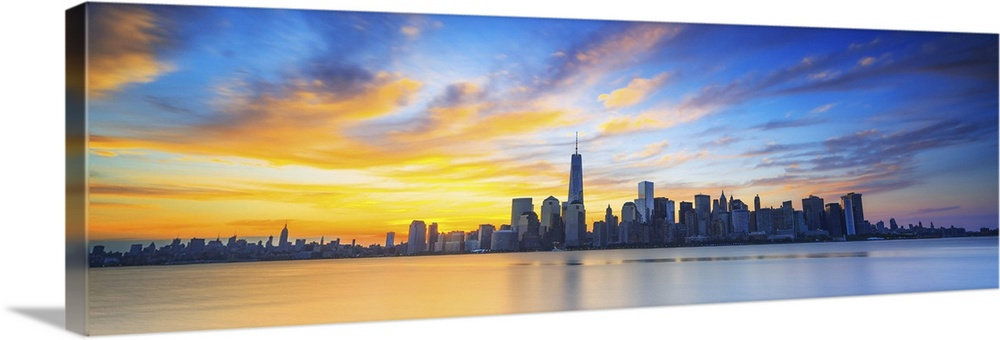 Large Solid-Faced Canvas Print Wall Art Print 60 x 20 entitled New York City, Manhattan, One World Trade Center, Freedom T... Solid-Faced Canvas Print entitled New York City, Manhattan, One World Trade Center, Freedom Tower, City skyline at sunrise.  USA, New York City, Manhattan, Lower Manhattan, One World Trade Center, Freedom Tower, City skyline at sunrise.  Multiple sizes available.  Primary colors within this image include Light Yellow, Sky Blue, White, Dark Navy Blue.  Made in the USA.  All products come with a 365 day workmanship guarantee.  Inks used are latex-based and designed to last.  Canvas is handcrafted and made-to-order in the United States using high quality artist-grade canvas.  Canvas depth is 1.25 and includes a finished backing with pre-installed hanging hardware.