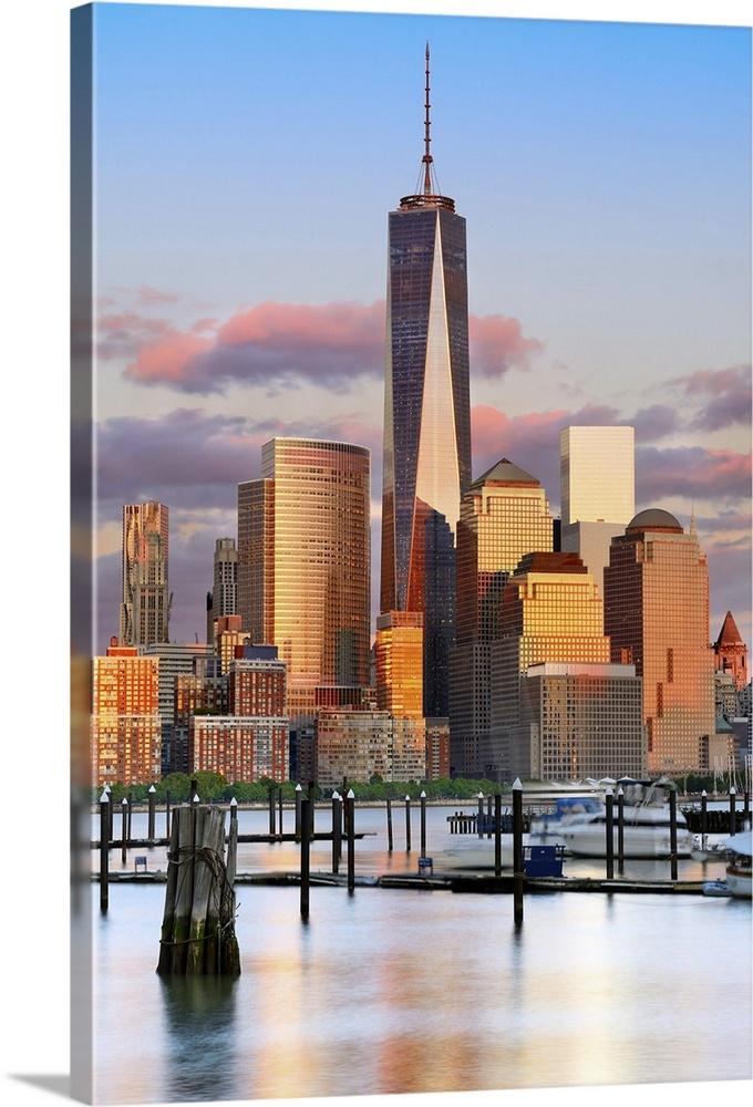 Large Solid-Faced Canvas Print Wall Art Print 24 x 36 entitled New York City, Manhattan, One World Trade Center, Freedom T... Solid-Faced Canvas Print entitled New York City, Manhattan, One World Trade Center, Freedom Tower, City skyline at sunset.  USA, New York City, Manhattan, Lower Manhattan, One World Trade Center, Freedom Tower, City skyline at sunset.  Multiple sizes available.  Primary colors within this image include Brown, Peach, Sky Blue, Black.  Made in USA.  All products come with a 365 day workmanship guarantee.  Archival-quality UV-resistant inks.  Canvas is handcrafted and made-to-order in the United States using high quality artist-grade canvas.  Canvas depth is 1.25 and includes a finished backing with pre-installed hanging hardware.