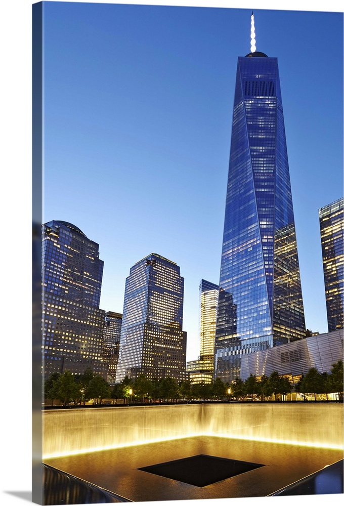 Large Solid-Faced Canvas Print Wall Art Print 24 x 36 entitled New York City, Manhattan, One World Trade Center, Ground Ze... Solid-Faced Canvas Print entitled New York City, Manhattan, One World Trade Center, Ground Zero memorial.  USA, New York City, Manhattan, Lower Manhattan, One World Trade Center, Freedom Tower, Ground Zero memorial at the site of the World Trade Center.  Multiple sizes available.  Primary colors within this image include White, Dark Forest Green, Pale Blue, Royal Blue.  Made in the USA.  All products come with a 365 day workmanship guarantee.  Inks used are latex-based and designed to last.  Canvas depth is 1.25 and includes a finished backing with pre-installed hanging hardware.  Canvas is handcrafted and made-to-order in the United States using high quality artist-grade canvas.