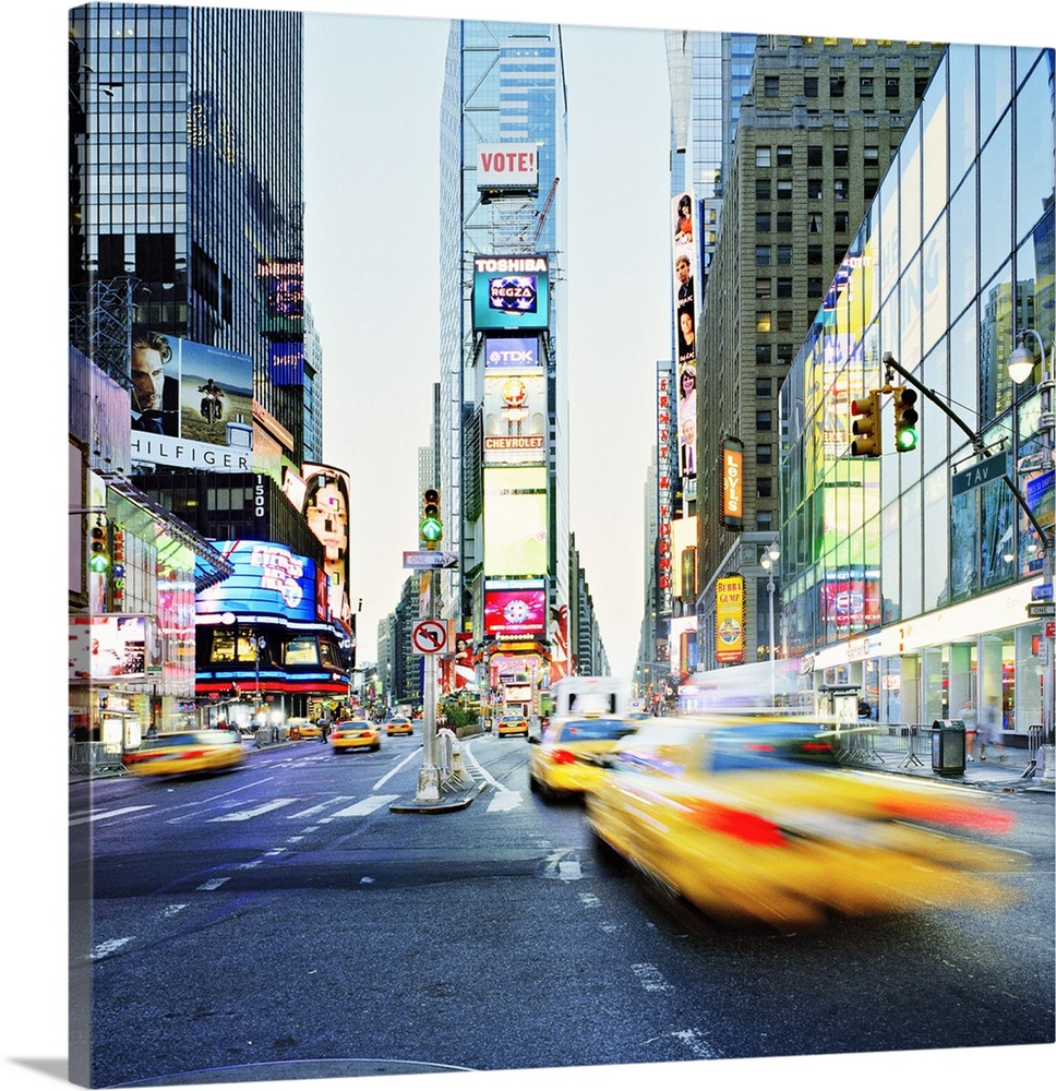 Large Solid-Faced Canvas Print Wall Art Print 20 x 20 entitled New York City, Times Square, Manhattan, Broadway Avenue and... Solid-Faced Canvas Print entitled New York City, Times Square, Manhattan, Broadway Avenue and Times Square.  United States, USA, New York State, New York City, Times Square, Manhattan, Travel Destination, Broadway Avenue and Times Square.  Multiple sizes available.  Primary colors within this image include Orange, Dark Blue, Black, White.  Made in the USA.  Satisfaction guaranteed.  Archival-quality UV-resistant inks.  Canvas depth is 1.25 and includes a finished backing with pre-installed hanging hardware.  Featuring a proprietary design, our canvases produce the tightest corners without any bubbles, ripples, or bumps and will not warp or sag over time.
