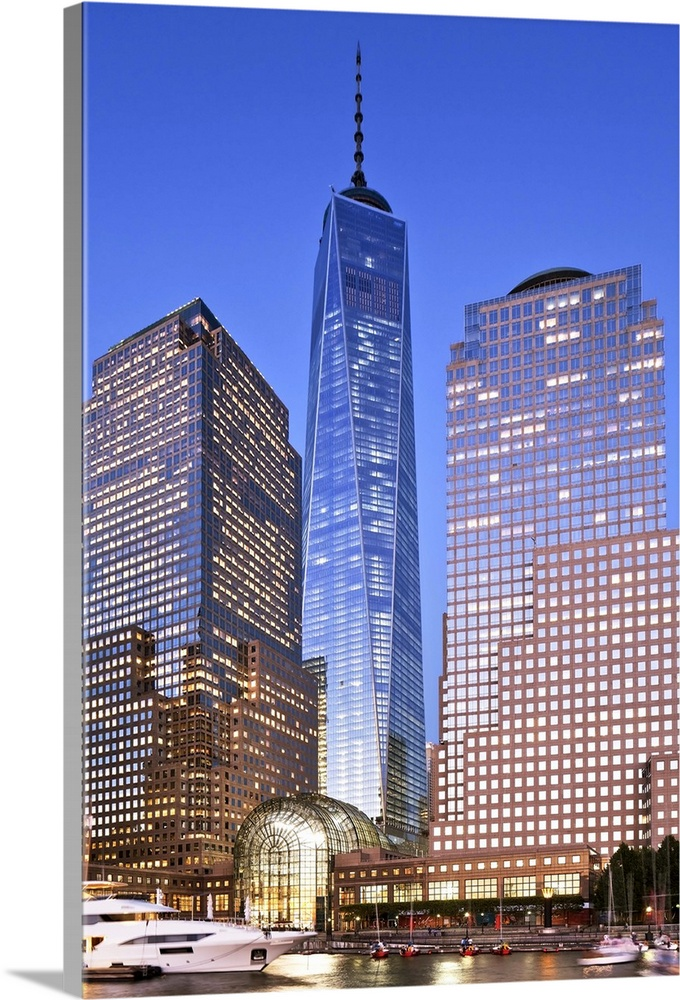 Large Solid-Faced Canvas Print Wall Art Print 24 x 36 entitled NYC, Lower Manhattan, One World Trade Center, Freedom Tower Solid-Faced Canvas Print entitled NYC, Lower Manhattan, One World Trade Center, Freedom Tower.  USA, New York City, Manhattan, Lower Manhattan, One World Trade Center, Freedom Tower, Tourist harbor and the Freedom Tower at dusk.  Multiple sizes available.  Primary colors within this image include Dark Red, Gray, White, Royal Blue.  Made in USA.  All products come with a 365 day workmanship guarantee.  Archival-quality UV-resistant inks.  Canvas depth is 1.25 and includes a finished backing with pre-installed hanging hardware.  Featuring a proprietary design, our canvases produce the tightest corners without any bubbles, ripples, or bumps and will not warp or sag over time.