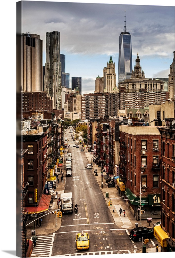 Large Solid-Faced Canvas Print Wall Art Print 24 x 36 entitled NYC, Manhattan, Lower East Side, Chinatown, Freedom Tower Solid-Faced Canvas Print entitled NYC, Manhattan, Lower East Side, Chinatown, Freedom Tower.  USA, New York City, Manhattan, Lower East Side, Chinatown, Chinatown, Freedom Tower in background.  Multiple sizes available.  Primary colors within this image include Brown, Light Yellow, Black, White.  Made in the USA.  All products come with a 365 day workmanship guarantee.  Archival-quality UV-resistant inks.  Archival inks prevent fading and preserve as much fine detail as possible with no over-saturation or color shifting.  Canvas depth is 1.25 and includes a finished backing with pre-installed hanging hardware.