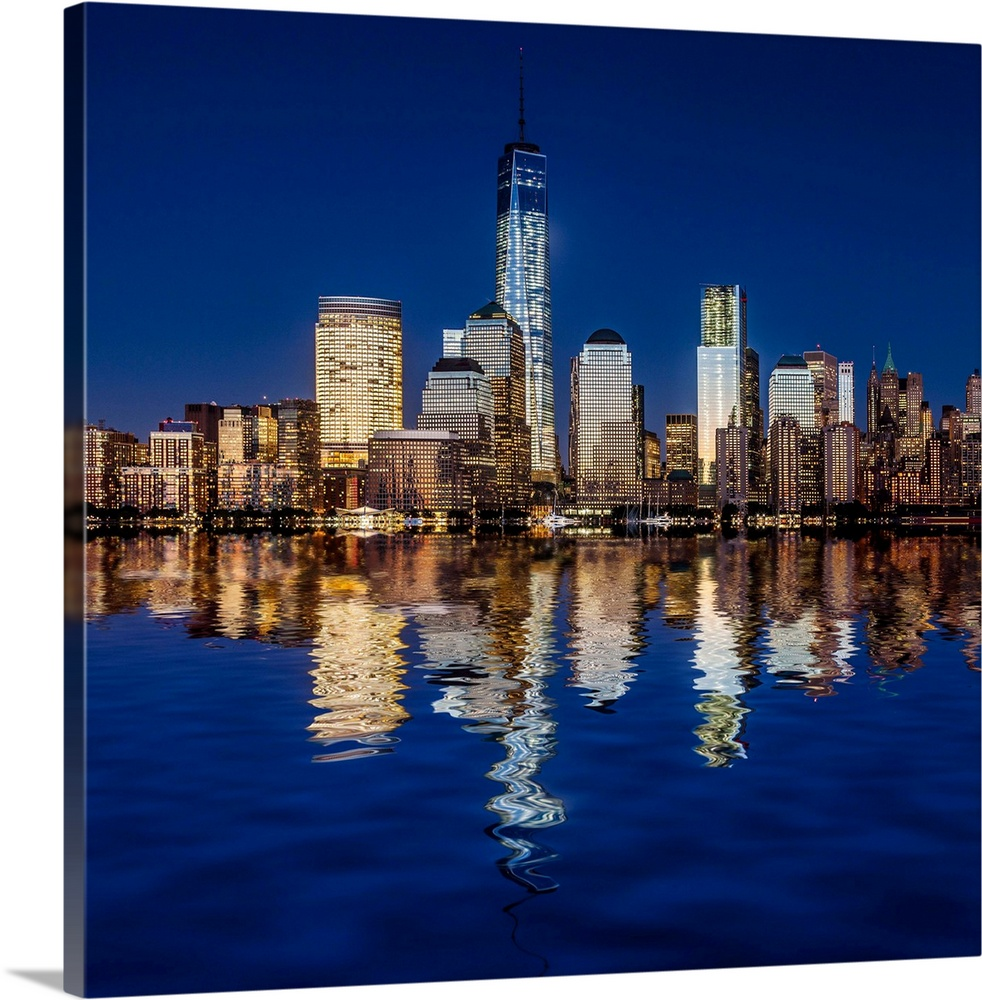 Large Solid-Faced Canvas Print Wall Art Print 24 x 24 entitled USA, New York City, Manhattan, One World Trade Center, Free... Solid-Faced Canvas Print entitled USA, New York City, Manhattan, One World Trade Center, Freedom Tower, At Night.  USA, New York City, Manhattan, Lower Manhattan, One World Trade Center, Freedom Tower, View from New Jersey towards Lower Manhattan, with the One World Trade Center, formerly Freedom Tower, at night.  Multiple sizes available.  Primary colors within this image include Brown, Dark Blue, Black, White.  Made in the USA.  Satisfaction guaranteed.  Inks used are latex-based and designed to last.  Archival inks prevent fading and preserve as much fine detail as possible with no over-saturation or color shifting.  Canvas depth is 1.25 and includes a finished backing with pre-installed hanging hardware.