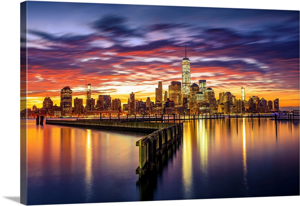 Large Solid-Faced Canvas Print Wall Art Print 36 x 24 entitled USA, New York City, Manhattan Skyline With Freedom Tower Fr... Solid-Faced Canvas Print entitled USA, New York City, Manhattan Skyline With Freedom Tower From New Jersey, At Sunrise.  USA, New York City, Manhattan, Lower Manhattan skyline with One World Trade Center and Freedom Tower from New Jersey, at sunrise.  Multiple sizes available.  Primary colors within this image include Orange, Dark Red, Peach, Black.  Made in USA.  Satisfaction guaranteed.  Archival-quality UV-resistant inks.  Canvas depth is 1.25 and includes a finished backing with pre-installed hanging hardware.  Featuring a proprietary design, our canvases produce the tightest corners without any bubbles, ripples, or bumps and will not warp or sag over time.