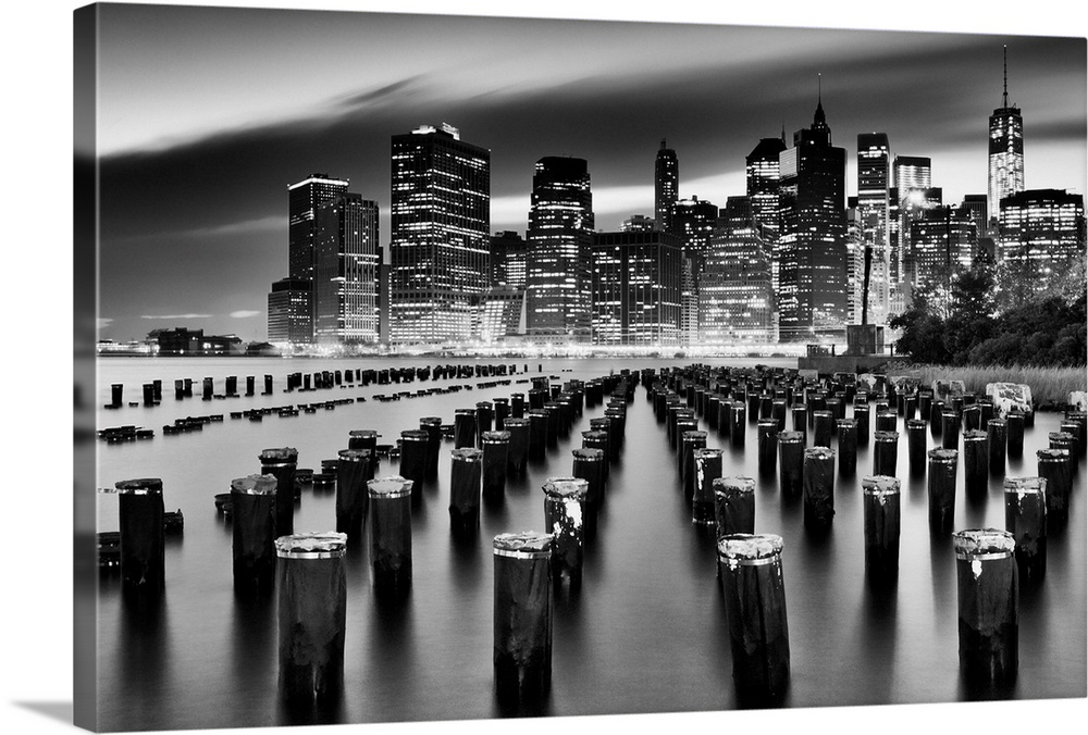 Large Solid-Faced Canvas Print Wall Art Print 36 x 24 entitled USA, New York City, Manhattan, View Of The Financial Distri... Solid-Faced Canvas Print entitled USA, New York City, Manhattan, View Of The Financial District Skyline From Brooklyn.  USA, New York City, Manhattan, Lower Manhattan, View of the Financial District skyline with the Freedom Tower in the background from Brooklyn.  Multiple sizes available.  Primary colors within this image include Black, Gray, Silver.  Made in USA.  Satisfaction guaranteed.  Inks used are latex-based and designed to last.  Archival inks prevent fading and preserve as much fine detail as possible with no over-saturation or color shifting.  Featuring a proprietary design, our canvases produce the tightest corners without any bubbles, ripples, or bumps and will not warp or sag over time.