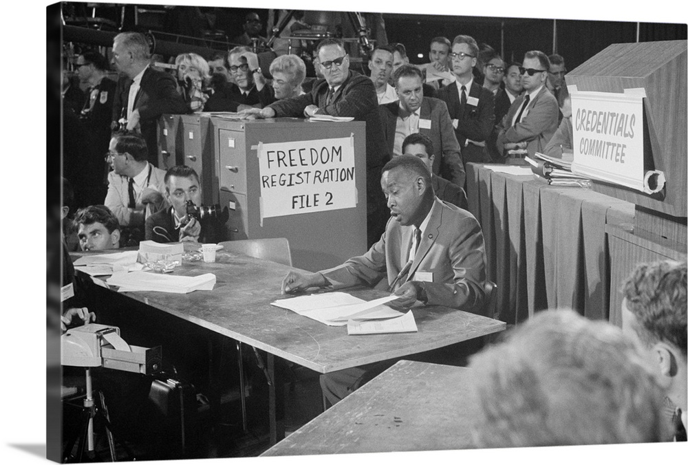 Large Solid-Faced Canvas Print Wall Art Print 36 x 24 entitled Aaron Henry Solid-Faced Canvas Print entitled Aaron Henry.  Aaron Henry, Chair of the Mississippi Freedom Democratic Party Delegation to Democratic Convention. Aug. 22, 1964.The MFDP challenged the legitimacy of the all-white delegation representing Mississippi. The issue embarrassed President Lyndon Johnson who decided to seat the all-white delegates, but still lost the Mississippi votes to his conservative opponent, Barry Goldwater.  Multiple sizes available.  Primary colors within this image include Dark Gray, Light Gray.  Made in USA.  Satisfaction guaranteed.  Inks used are latex-based and designed to last.  Archival inks prevent fading and preserve as much fine detail as possible with no over-saturation or color shifting.  Canvas is handcrafted and made-to-order in the United States using high quality artist-grade canvas.