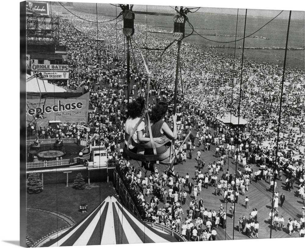 Large Gallery-Wrapped Canvas Wall Art Print 20 x 16 entitled Beach Crowds As Seen From Parachute Jump At Steeple Park. Con... Gallery-Wrapped Canvas entitled Beach Crowds As Seen From Parachute Jump At Steeple Park. Coney Island NY 1950.  Multiple sizes available.  Primary colors within this image include Dark Gray Light Gray.  Made in the USA.  Satisfaction guaranteed.  Archival-quality UV-resistant inks.  Canvas is a 65 polyester 35 cotton base with two acrylic latex primer basecoats and a semi-gloss inkjet receptive topcoat.  Museum-quality artist-grade canvas mounted on sturdy wooden stretcher bars 1.5 thick.  Comes ready to hang.