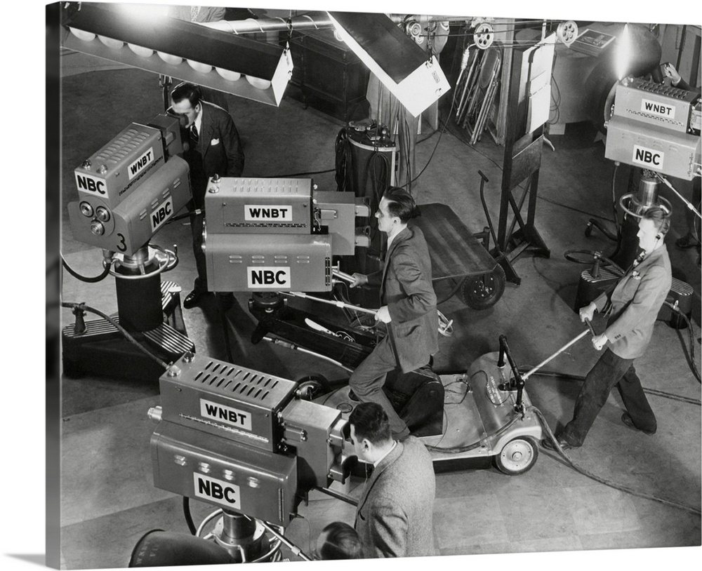 Large Gallery-Wrapped Canvas Wall Art Print 24 x 19 entitled Cameras are tested on the television studio set before the pr... Gallery-Wrapped Canvas entitled Cameras are tested on the television studio set before the program goes on the air,.  Cameras are tested on the television studio set before the program goes on the air.  Multiple sizes available.  Primary colors within this image include Dark Gray, Light Gray.  Made in the USA.  Satisfaction guaranteed.  Archival-quality UV-resistant inks.  Canvas is a 65 polyester, 35 cotton base, with two acrylic latex primer basecoats and a semi-gloss inkjet receptive topcoat.  Canvases are stretched across a 1.5 inch thick wooden frame with easy-to-mount hanging hardware.