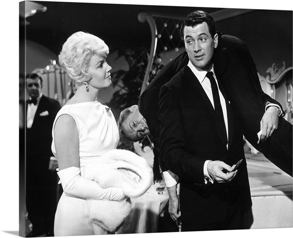 Large Solid-Faced Canvas Print Wall Art Print 30 x 24 entitled Doris Day, Nick Adams, Rock Hudson, Pillow Talk Solid-Faced Canvas Print entitled Doris Day, Nick Adams, Rock Hudson, Pillow Talk.  Multiple sizes available.  Primary colors within this image include Black, Gray, White.  Made in USA.  Satisfaction guaranteed.  Archival-quality UV-resistant inks.  Canvas depth is 1.25 and includes a finished backing with pre-installed hanging hardware.  Featuring a proprietary design, our canvases produce the tightest corners without any bubbles, ripples, or bumps and will not warp or sag over time.