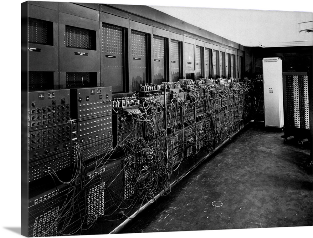 Large Solid-Faced Canvas Print Wall Art Print 40 x 30 entitled ENIAC computer was the first general-purpose electronic dig... Solid-Faced Canvas Print entitled ENIAC computer was the first general-purpose electronic digital computer.  ENIAC computer was the first general-purpose electronic digital computer. Electronic Numerical Integrator And Computer was 150 feet wide with 20 banks of flashing lights. c. 1946.  Multiple sizes available.  Primary colors within this image include Black, Gray, Silver.  Made in the USA.  All products come with a 365 day workmanship guarantee.  Archival-quality UV-resistant inks.  Featuring a proprietary design, our canvases produce the tightest corners without any bubbles, ripples, or bumps and will not warp or sag over time.  Canvas is handcrafted and made-to-order in the United States using high quality artist-grade canvas.