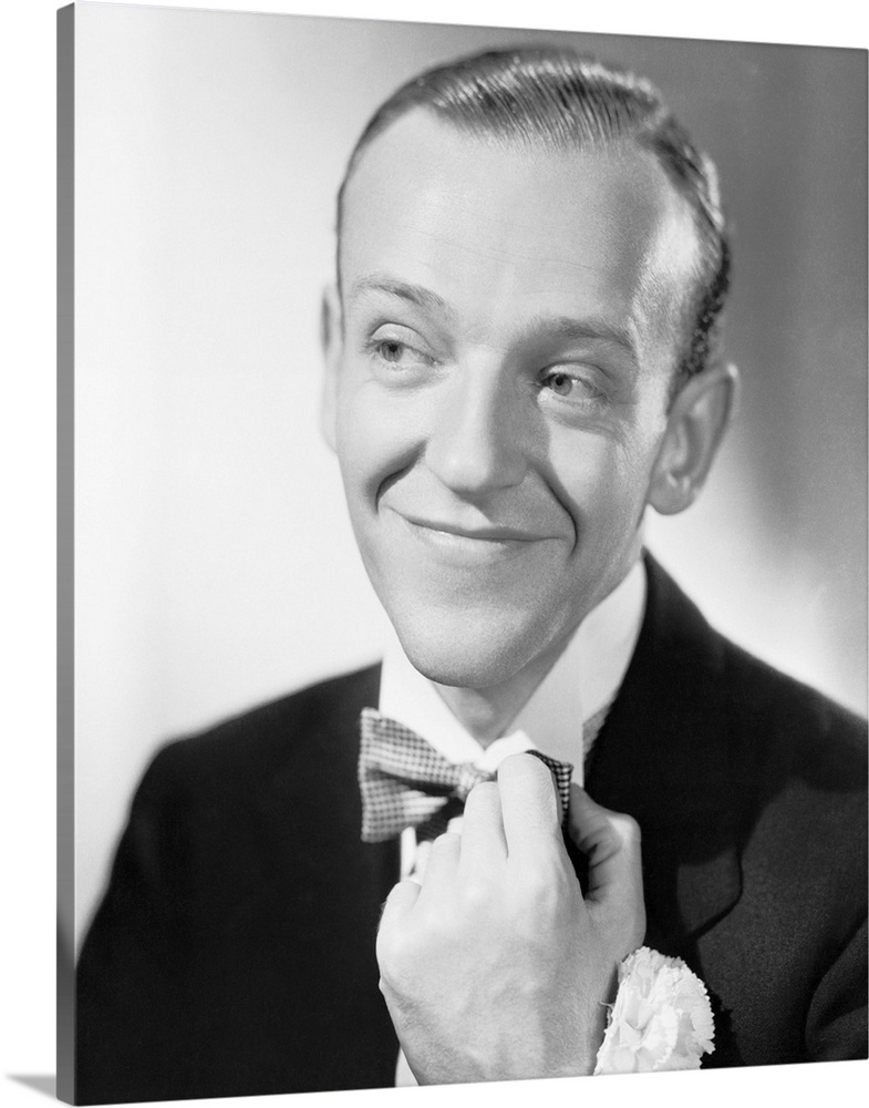 Large Solid-Faced Canvas Print Wall Art Print 24 x 30 entitled Fred Astaire in Swing Time - Vintage Publicity Photo Solid-Faced Canvas Print entitled Fred Astaire in Swing Time - Vintage Publicity Photo.  Multiple sizes available.  Primary colors within this image include Dark Gray, Gray, White.  Made in USA.  Satisfaction guaranteed.  Inks used are latex-based and designed to last.  Canvas is handcrafted and made-to-order in the United States using high quality artist-grade canvas.  Featuring a proprietary design, our canvases produce the tightest corners without any bubbles, ripples, or bumps and will not warp or sag over time.
