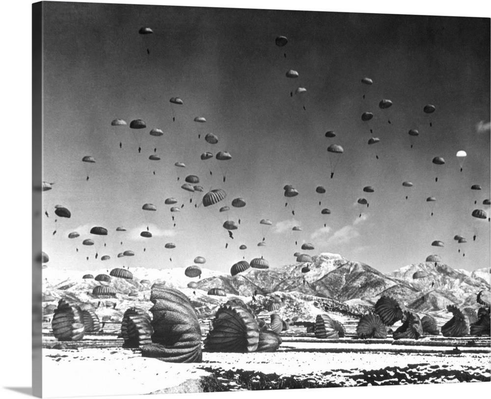 Large Gallery-Wrapped Canvas Wall Art Print 20 x 16 entitled Men And Equipment Being Parachuted To Earth In Operation Cond... Gallery-Wrapped Canvas entitled Men And Equipment Being Parachuted To Earth In Operation Conducted By United Nations.  Multiple sizes available.  Primary colors within this image include Dark Gray Silver.  Made in the USA.  All products come with a 365 day workmanship guarantee.  Inks used are latex-based and designed to last.  Canvas is designed to prevent fading.  Museum-quality artist-grade canvas mounted on sturdy wooden stretcher bars 1.5 thick.  Comes ready to hang.