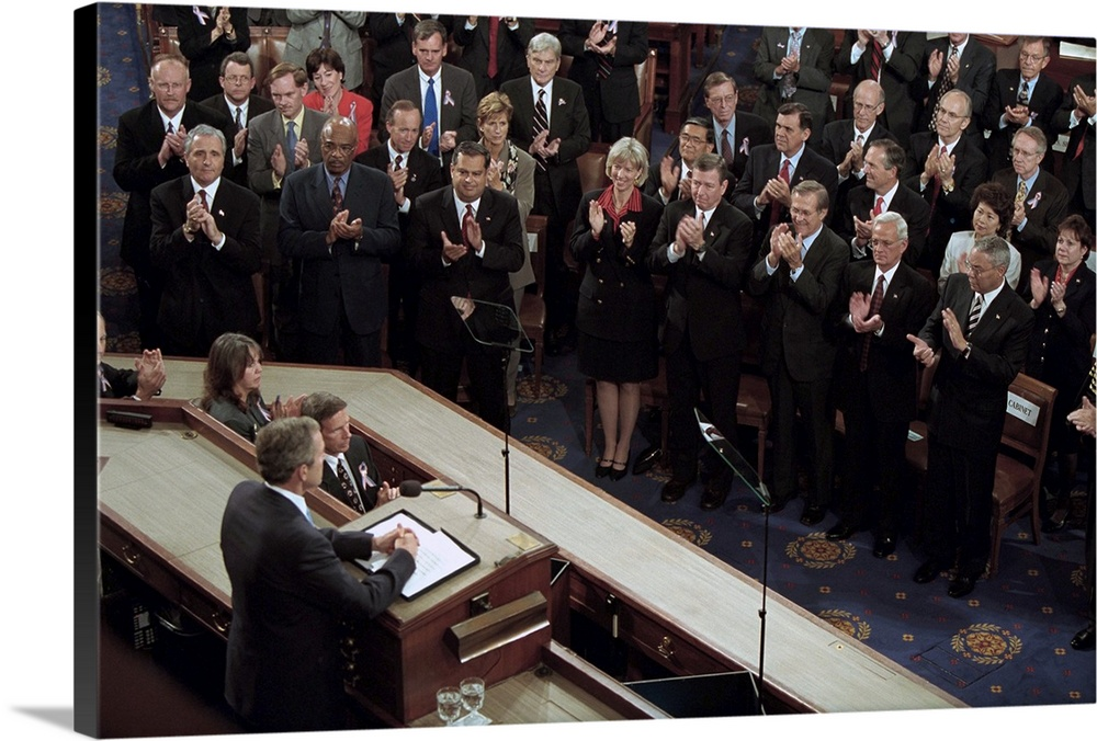 Large Solid-Faced Canvas Print Wall Art Print 36 x 24 entitled President George W, Bush speaks to a Joint Session of Congress Solid-Faced Canvas Print entitled President George W, Bush speaks to a Joint Session of Congress.  President George W. Bush speaks to a Joint Session of Congress about the 9-11 Terrorist Attacks. Sept. 20, 2001. He stated the attacks were motivated by Al Qaedas hatred of our freedoms our freedom of religion, our freedom of speech, our freedom to vote and assemble and disagree with each other.  Multiple sizes available.  Primary colors within this image include Black, Gray, Muted Blue, Pale Blue.  Made in USA.  Satisfaction guaranteed.  Inks used are latex-based and designed to last.  Archival inks prevent fading and preserve as much fine detail as possible with no over-saturation or color shifting.  Canvas depth is 1.25 and includes a finished backing with pre-installed hanging hardware.