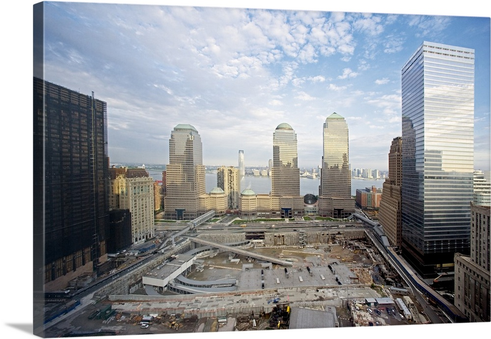 Large Solid-Faced Canvas Print Wall Art Print 36 x 24 entitled The 16 acre World Trade Center site cleared and prepared fo... Solid-Faced Canvas Print entitled The 16 acre World Trade Center site cleared and prepared for reconstruction.  The 16 acre World Trade Center site cleared and prepared for reconstruction. The new WTC will include One World Trade Center Freedom Tower, memorial pools on the footprints of the Twin Towers and a 9-11 Museum. At right is the new WTC 7, replacing the third WTC skyscraper to collapse on Sept. 11, 2001. May 20, 2006. Photo by Carol Highsmith.  Multiple sizes available.  Primary colors within this image include Sky Blue, Dark Gray, Gray, White.  Made in USA.  All products come with a 365 day workmanship guarantee.  Archival-quality UV-resistant inks.  Canvas is handcrafted and made-to-order in the United States using high quality artist-grade canvas.  Featuring a proprietary design, our canvases produce the tightest corners without any bubbles, ripples, or bumps and will not warp or sag over time.