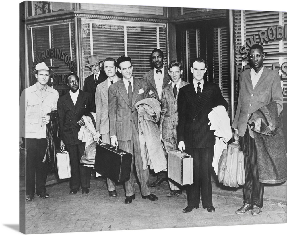Large Solid-Faced Canvas Print Wall Art Print 30 x 24 entitled The First 'Freedom Riders' Holding Suitcases Outside Office... Solid-Faced Canvas Print entitled The First Freedom Riders Holding Suitcases Outside Office Of Attorney S.W. Robinson..  Multiple sizes available.  Primary colors within this image include Dark Gray, Silver.  Made in USA.  All products come with a 365 day workmanship guarantee.  Inks used are latex-based and designed to last.  Featuring a proprietary design, our canvases produce the tightest corners without any bubbles, ripples, or bumps and will not warp or sag over time.  Archival inks prevent fading and preserve as much fine detail as possible with no over-saturation or color shifting.
