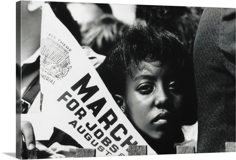 Large Solid-Faced Canvas Print Wall Art Print 36 x 24 entitled Young Woman Demonstrator At March On Washington For Jobs An... Solid-Faced Canvas Print entitled Young Woman Demonstrator At March On Washington For Jobs And Freedom.  Multiple sizes available.  Primary colors within this image include Black, Gray, White.  Made in USA.  Satisfaction guaranteed.  Archival-quality UV-resistant inks.  Archival inks prevent fading and preserve as much fine detail as possible with no over-saturation or color shifting.  Canvas is handcrafted and made-to-order in the United States using high quality artist-grade canvas.