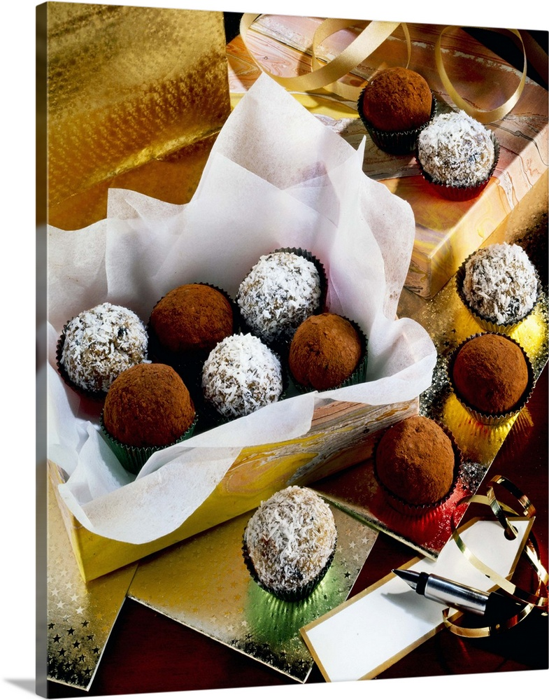 Large Solid-Faced Canvas Print Wall Art Print 24 x 30 entitled Open Box Of Truffles With Gift Wrap, Pen And Gift Tag Solid-Faced Canvas Print entitled Open Box Of Truffles With Gift Wrap, Pen And Gift Tag.  Multiple sizes available.  Primary colors within this image include Dark Red, Brown, Black, White.  Made in the USA.  Satisfaction guaranteed.  Archival-quality UV-resistant inks.  Archival inks prevent fading and preserve as much fine detail as possible with no over-saturation or color shifting.  Canvas is handcrafted and made-to-order in the United States using high quality artist-grade canvas.
