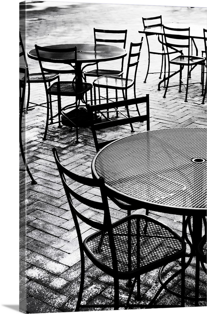 Large Solid-Faced Canvas Print Wall Art Print 20 x 30 entitled Tables & Chairs I Solid-Faced Canvas Print entitled Tables  Chairs I.  Empty Chairs.  Multiple sizes available.  Primary colors within this image include Black, Gray, Silver.  Made in the USA.  All products come with a 365 day workmanship guarantee.  Archival-quality UV-resistant inks.  Canvas is handcrafted and made-to-order in the United States using high quality artist-grade canvas.  Canvas depth is 1.25 and includes a finished backing with pre-installed hanging hardware.