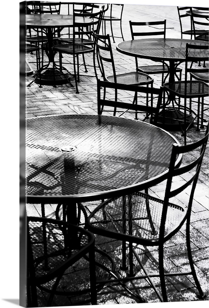 Large Solid-Faced Canvas Print Wall Art Print 20 x 30 entitled Tables & Chairs II Solid-Faced Canvas Print entitled Tables  Chairs II.  Black and white photograph taken of outdoor tables and chairs that sit on a brick sidewalk.  Multiple sizes available.  Primary colors within this image include Black, Gray, White.  Made in USA.  Satisfaction guaranteed.  Archival-quality UV-resistant inks.  Canvas depth is 1.25 and includes a finished backing with pre-installed hanging hardware.  Canvas is handcrafted and made-to-order in the United States using high quality artist-grade canvas.