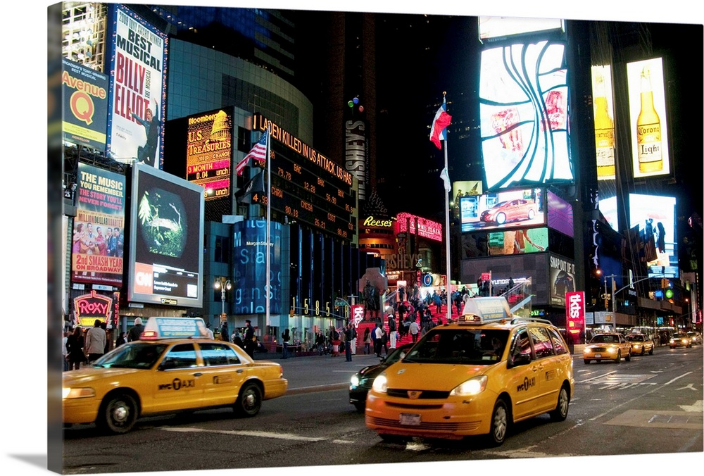 Large Solid-Faced Canvas Print Wall Art Print 30 x 20 entitled Times Square II Solid-Faced Canvas Print entitled Times Square II.  Multiple sizes available.  Primary colors within this image include Brown, Pink, Black, Silver.  Made in USA.  All products come with a 365 day workmanship guarantee.  Archival-quality UV-resistant inks.  Archival inks prevent fading and preserve as much fine detail as possible with no over-saturation or color shifting.  Canvas is handcrafted and made-to-order in the United States using high quality artist-grade canvas.