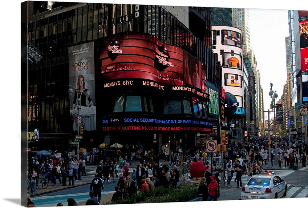 Large Solid-Faced Canvas Print Wall Art Print 30 x 20 entitled Times Square IV Solid-Faced Canvas Print entitled Times Square IV.  Multiple sizes available.  Primary colors within this image include Dark Red, Plum, Black, White.  Made in USA.  All products come with a 365 day workmanship guarantee.  Archival-quality UV-resistant inks.  Canvas is handcrafted and made-to-order in the United States using high quality artist-grade canvas.  Archival inks prevent fading and preserve as much fine detail as possible with no over-saturation or color shifting.