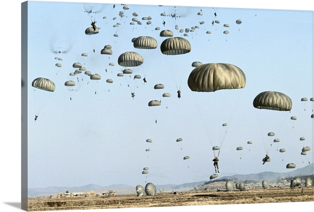 Large Solid-Faced Canvas Print Wall Art Print 36 x 24 entitled 1st Brigade, 82nd US Airborne Division Paratroopers, Osan, ... Solid-Faced Canvas Print entitled 1st Brigade, 82nd US Airborne Division Paratroopers, Osan, South Korea.  Koreans Watch Air Maneuvers. Osan, South Korea About 750 men of the 1st Brigade, 82nd U.S. Airborne Division drooped from 14 6141 Starlifters into this area, some 30 miles south of Seoul to the rescue of South Korea under invasion from the North after flying 8,000 miles from their home base in Fort Bragg, North Carolina. This was not real war but a joint U.S.-South Korea exercise called Freedom Vault designed to demonstrate the capability of deploying U.S. forces from continental America to Asia to help its allies in emergencies. The war game continued through Saturday.  Multiple sizes available.  Primary colors within this image include Black, Gray, Pale Blue.  Made in USA.  All products come with a 365 day workmanship guarantee.  Archival-quality UV-resistant inks.  Archival inks prevent fading and preserve as much fine detail as possible with no over-saturation or color shifting.  Featuring a proprietary design, our canvases produce the tightest corners without any bubbles, ripples, or bumps and will not warp or sag over time.