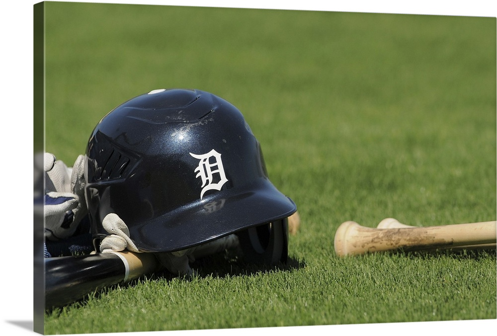 Large Solid-Faced Canvas Print Wall Art Print 30 x 20 entitled A Detroit Tigers batting helmet and baseball bat sit on the... Solid-Faced Canvas Print entitled A Detroit Tigers batting helmet and baseball bat sit on the field.  A Detroit Tigers batting helmet and baseball bat sit on the field during spring training workouts at Joker Marchant Stadium on February 28, 2010 in Lakeland, Florida.  Multiple sizes available.  Primary colors within this image include Dark Yellow, Dark Gray, White.  Made in the USA.  Satisfaction guaranteed.  Inks used are latex-based and designed to last.  Canvas is handcrafted and made-to-order in the United States using high quality artist-grade canvas.  Archival inks prevent fading and preserve as much fine detail as possible with no over-saturation or color shifting.