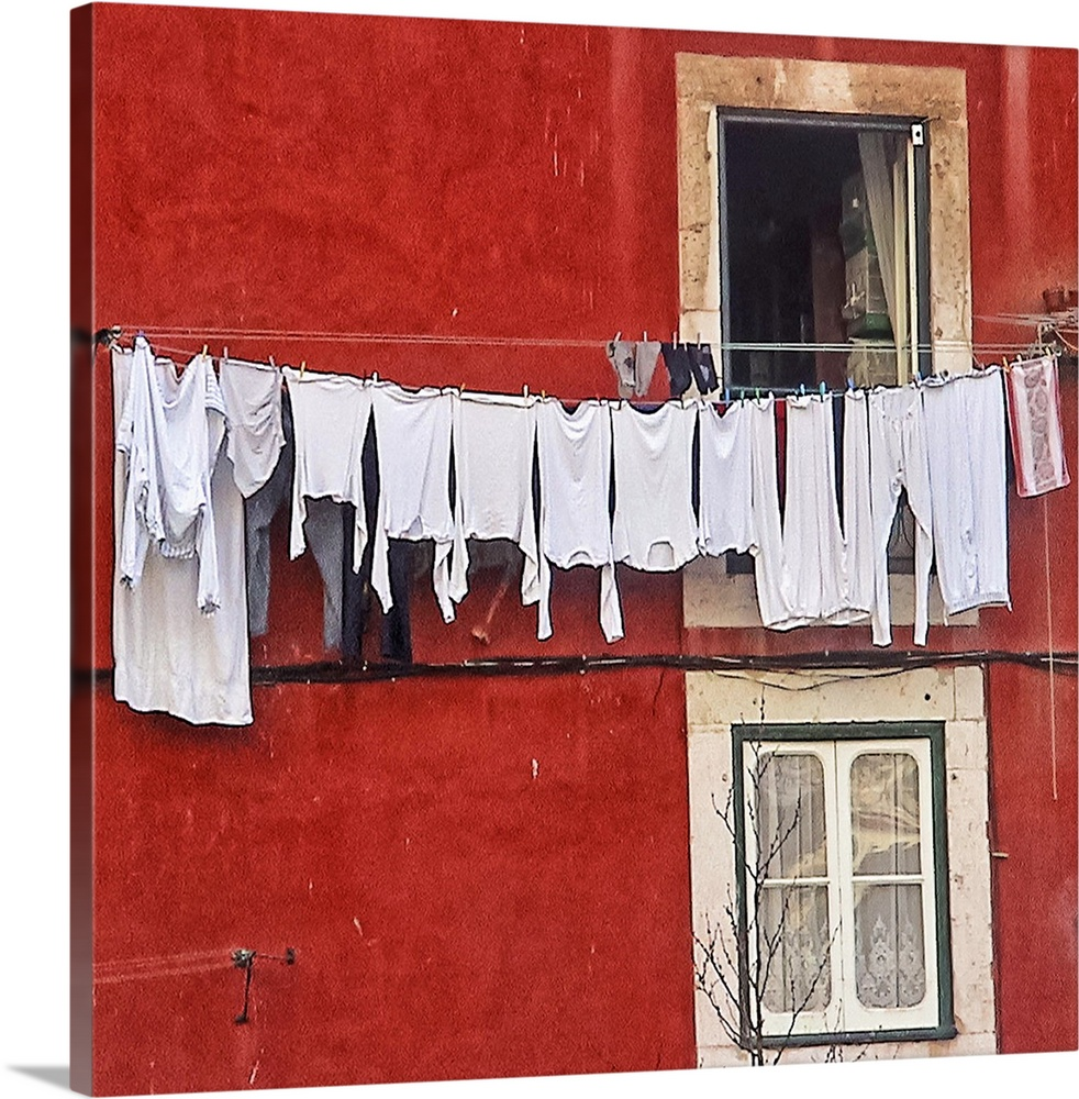 Large Gallery-Wrapped Canvas Wall Art Print 20 x 18 entitled A window with a clothes drying on the clothesline in Lisbon, ... Gallery-Wrapped Canvas entitled A window with a clothes drying on the clothesline in Lisbon, Portugal.  Barrio de Alfama, Lisboa, Portugal. 20 Marzo 2005.  Multiple sizes available.  Primary colors within this image include Dark Red, Pink, Black, White.  Made in the USA.  Satisfaction guaranteed.  Inks used are latex-based and designed to last.  Canvas frames are built with farmed or reclaimed domestic pine or poplar wood.  Canvases have a UVB protection built in to protect against fading and moisture and are designed to last for over 100 years.
