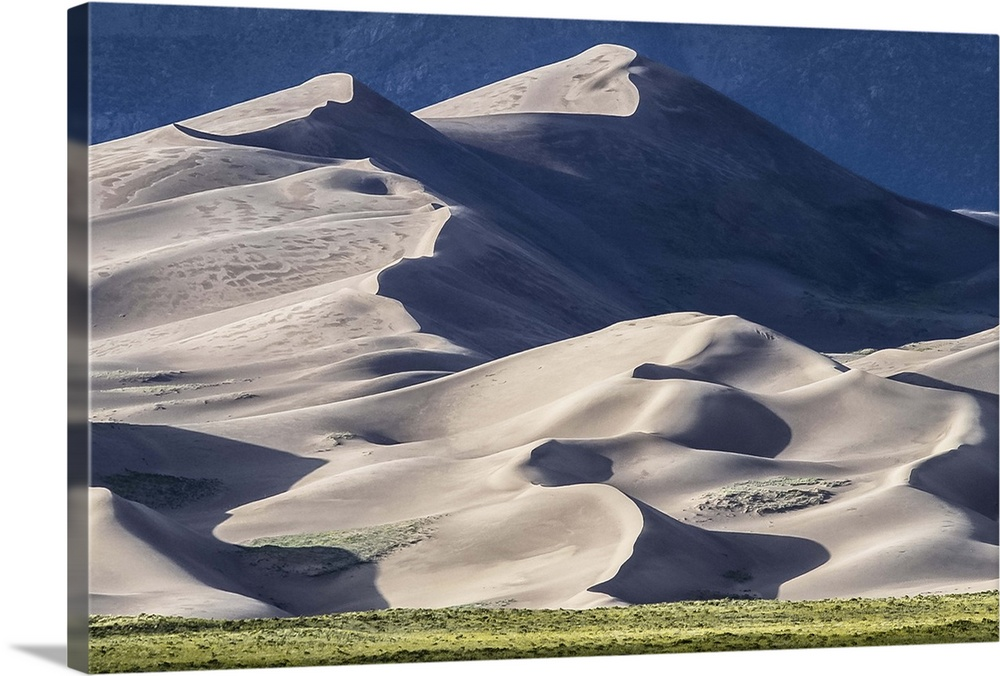 Large Solid-Faced Canvas Print Wall Art Print 30 x 20 entitled Afternoon shadows Solid-Faced Canvas Print entitled Afternoon shadows.  Late afternoon shot of the dunes catching the shadows. Great Sand Dunes NP.  Multiple sizes available.  Primary colors within this image include Silver, Dark Forest Green, Dark Navy Blue.  Made in the USA.  Satisfaction guaranteed.  Archival-quality UV-resistant inks.  Canvas is handcrafted and made-to-order in the United States using high quality artist-grade canvas.  Featuring a proprietary design, our canvases produce the tightest corners without any bubbles, ripples, or bumps and will not warp or sag over time.