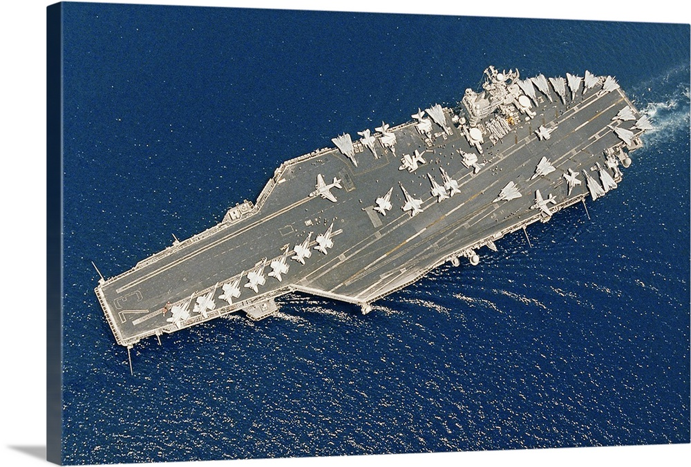 Large Solid-Faced Canvas Print Wall Art Print 36 x 24 entitled Aircraft carrier USS George Washington and Carrier Air Wing... Solid-Faced Canvas Print entitled Aircraft carrier USS George Washington and Carrier Air Wing Seven.  The carrier and crew are in the Arabian Gulf in support of Operation Iraqi Freedom, Apr 2004.  Multiple sizes available.  Primary colors within this image include Gray, White, Dark Navy Blue.  Made in USA.  All products come with a 365 day workmanship guarantee.  Archival-quality UV-resistant inks.  Featuring a proprietary design, our canvases produce the tightest corners without any bubbles, ripples, or bumps and will not warp or sag over time.  Archival inks prevent fading and preserve as much fine detail as possible with no over-saturation or color shifting.