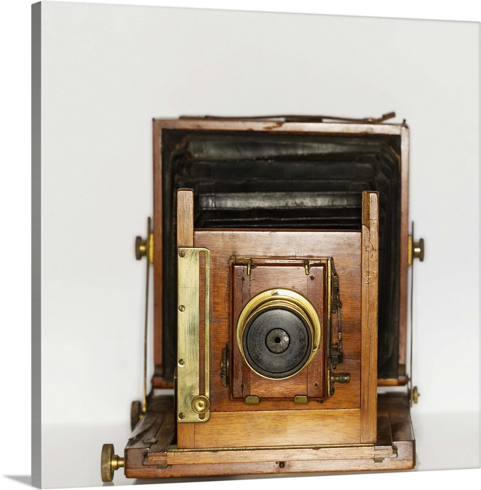 Large Gallery-Wrapped Canvas Wall Art Print 16 x 16 entitled An antique camera Gallery-Wrapped Canvas entitled An antique camera.  Multiple sizes available.  Primary colors within this image include Brown Peach Gray Silver.  Made in USA.  All products come with a 365 day workmanship guarantee.  Archival-quality UV-resistant inks.  Canvases have a UVB protection built in to protect against fading and moisture and are designed to last for over 100 years.  Museum-quality artist-grade canvas mounted on sturdy wooden stretcher bars 1.5 thick.  Comes ready to hang.