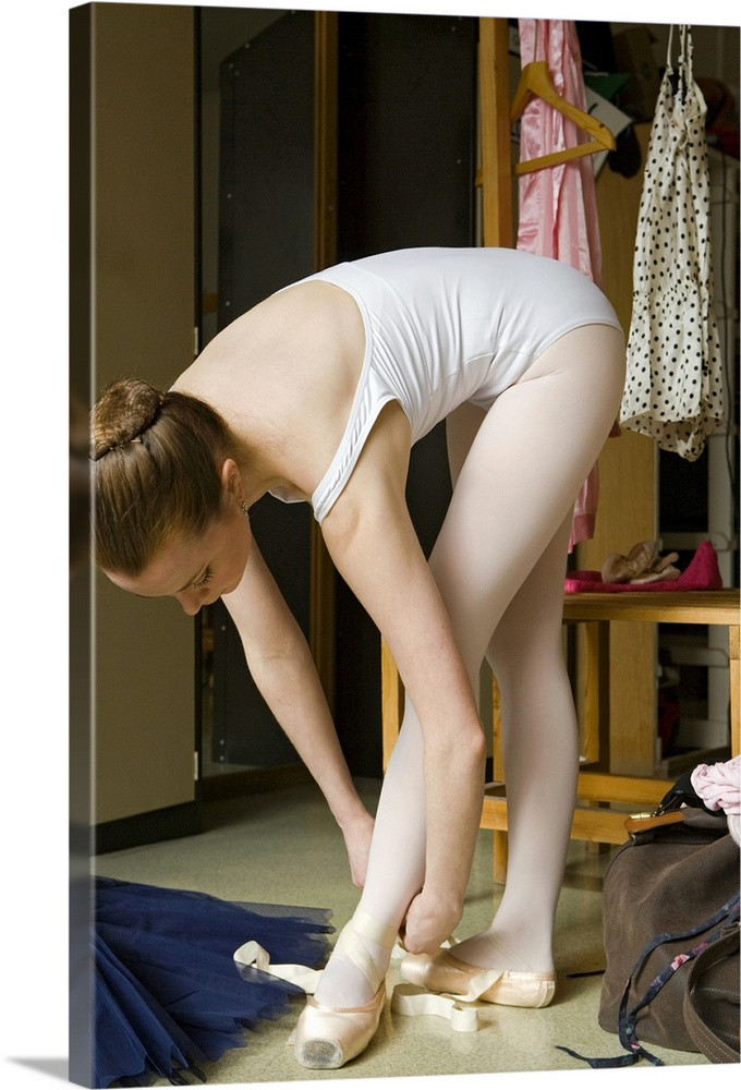 Large Gallery-Wrapped Canvas Wall Art Print 16 x 24 entitled Ballerina putting on pointe shoes Gallery-Wrapped Canvas entitled Ballerina putting on pointe shoes.  Multiple sizes available.  Primary colors within this image include Brown, Black, Si