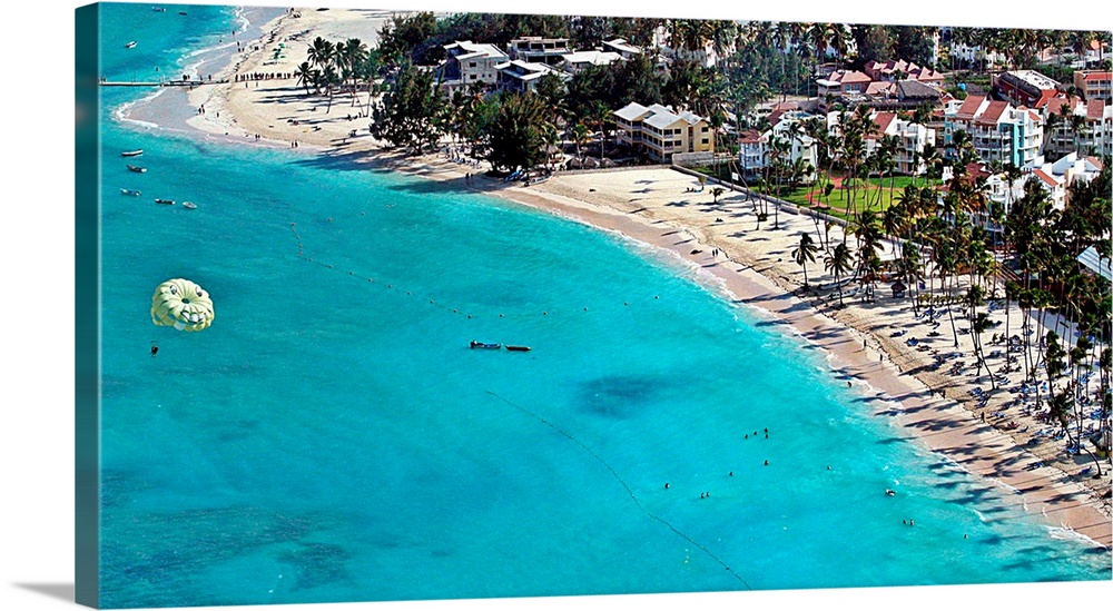 Large Gallery-Wrapped Canvas Wall Art Print 30 x 16 entitled Bavaro Beach Gallery-Wrapped Canvas entitled Bavaro Beach.  Parachute ride over Bavaro beach at Punta Cana.  Multiple sizes available.  Primary colors within this image include Black White Dark Forest Green Teal.  Made in USA.  All products come with a 365 day workmanship guarantee.  Archival-quality UV-resistant inks.  Canvas is acid-free and 20 millimeters thick.  Museum-quality artist-grade canvas mounted on sturdy wooden stretcher bars 1.5 thick.  Comes ready to hang.