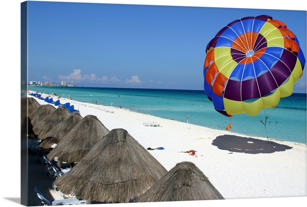 Large Gallery-Wrapped Canvas Wall Art Print 24 x 16 entitled Beach and parasailing parachute, Hotel Zone, Cancun, Mexico Gallery-Wrapped Canvas entitled Beach and parasailing parachute Hotel Zone Cancun Mexico.  Multiple sizes available.  Primary colors within this image include Dark Red Black White Gray Blue.  Made in the USA.  Satisfaction guaranteed.  Inks used are latex-based and designed to last.  Canvas is a 65 polyester 35 cotton base with two acrylic latex primer basecoats and a semi-gloss inkjet receptive topcoat.  Canvas frames are built with farmed or reclaimed domestic pine or poplar wood.