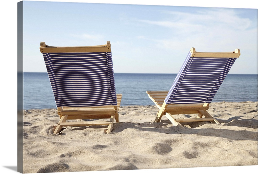 Large Solid-Faced Canvas Print Wall Art Print 30 x 20 entitled Beach Chairs, Boltenhagen, Mecklenburg-Vorpommern, Baltic S... Solid-Faced Canvas Print entitled Beach Chairs, Boltenhagen, Mecklenburg-Vorpommern, Baltic Sea, Germany.  Multiple sizes available.  Primary colors within this image include Brown, White, Dark Navy Blue.  Made in USA.  Satisfaction guaranteed.  Inks used are latex-based and designed to last.  Featuring a proprietary design, our canvases produce the tightest corners without any bubbles, ripples, or bumps and will not warp or sag over time.  Canvas depth is 1.25 and includes a finished backing with pre-installed hanging hardware.