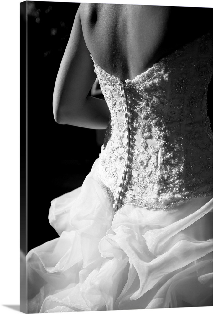 Large Solid-Faced Canvas Print Wall Art Print 20 x 30 entitled Bride wearing white wedding dress. Solid-Faced Canvas Print entitled Bride wearing white wedding dress..  Multiple sizes available.  Primary colors within this image include Black, Gray, White.  Made in the USA.  Satisfaction guaranteed.  Archival-quality UV-resistant inks.  Featuring a proprietary design, our canvases produce the tightest corners without any bubbles, ripples, or bumps and will not warp or sag over time.  Archival inks prevent fading and preserve as much fine detail as possible with no over-saturation or color shifting.