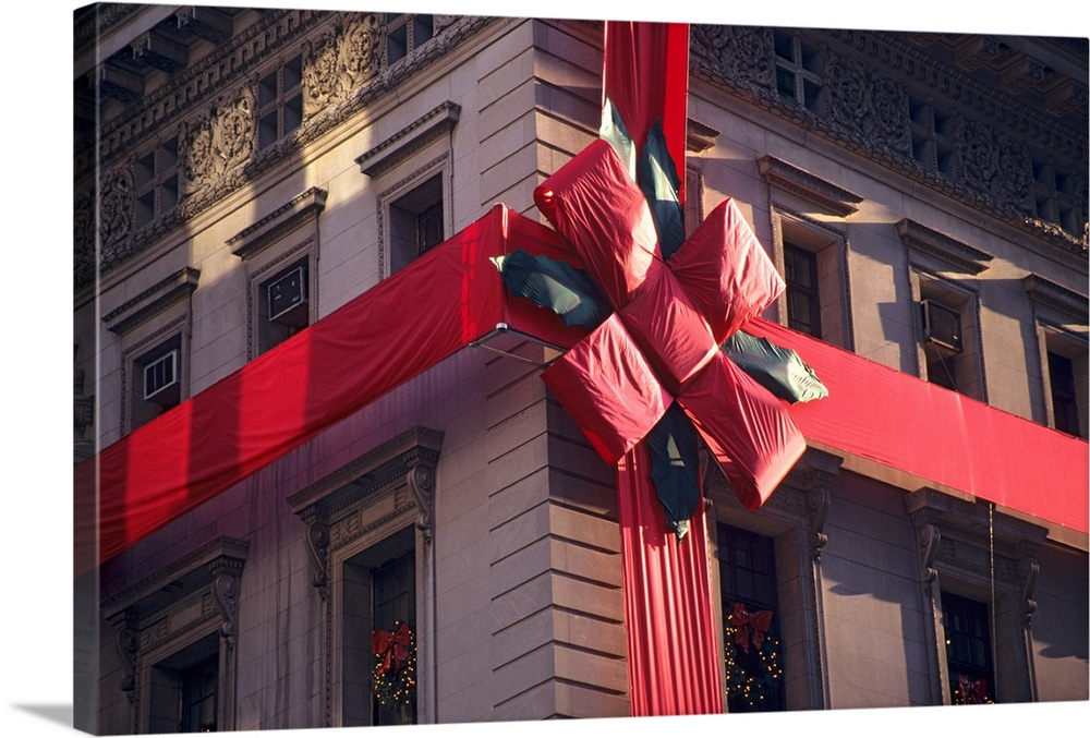 Large Gallery-Wrapped Canvas Wall Art Print 24 x 16 entitled Cartier on 5th avenue, decorated for Christmas Gallery-Wrapped Canvas entitled Cartier on 5th avenue, decorated for Christmas.  Multiple sizes available.  Primary colors within this image include Pink, Gray, White, Dark Forest Green.  Made in the USA.  Satisfaction guaranteed.  Inks used are latex-based and designed to last.  Canvas frames are built with farmed or reclaimed domestic pine or poplar wood.  Canvases have a UVB protection built in to protect against fading and moisture and are designed to last for over 100 years.