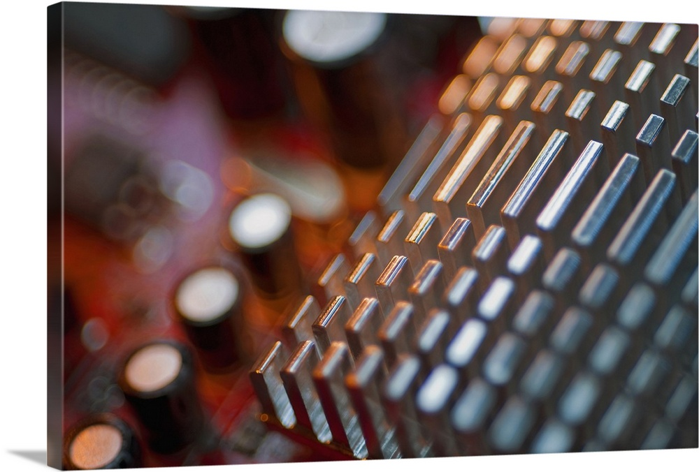 Large Gallery-Wrapped Canvas Wall Art Print 24 x 16 entitled Close-up of a heatsink on a mother board Gallery-Wrapped Canvas entitled Close-up of a heatsink on a mother board.  Multiple sizes available.  Primary colors within this image include Brown Dark Gray Silver.  Made in USA.  Satisfaction guaranteed.  Archival-quality UV-resistant inks.  Canvas is designed to prevent fading.  Canvases have a UVB protection built in to protect against fading and moisture and are designed to last for over 100 years.