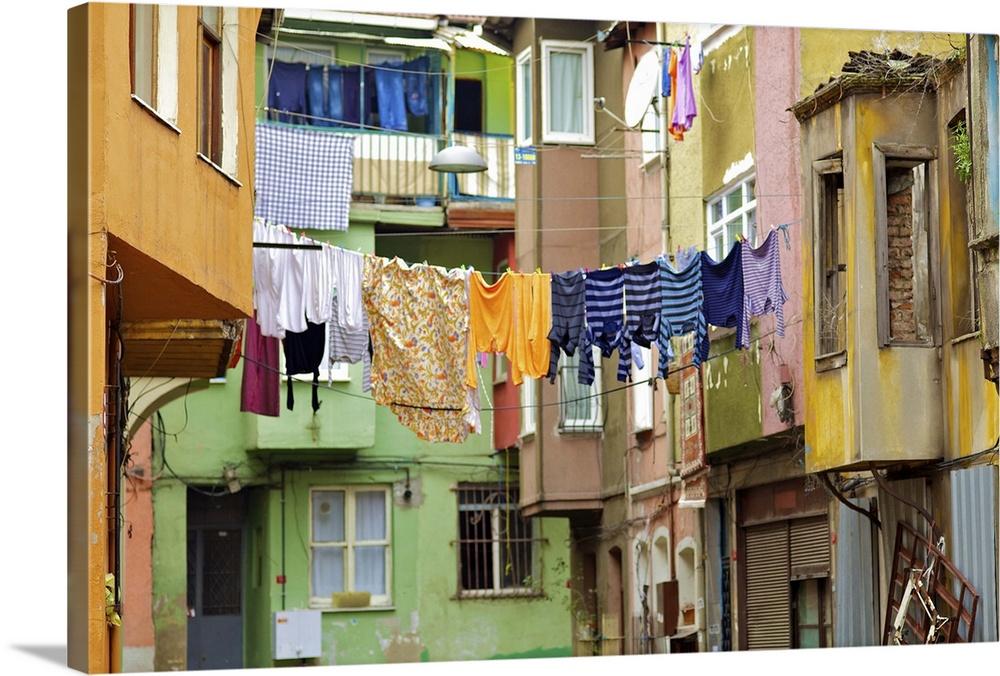 Large Gallery-Wrapped Canvas Wall Art Print 24 x 16 entitled Clothes hanging from apartment buildings, Turkey Gallery-Wrapped Canvas entitled Clothes hanging from apartment buildings, Turkey.  Multiple sizes available.  Primary colors within this image include Brown, Peach, Black, Muted Blue.  Made in the USA.  All products come with a 365 day workmanship guarantee.  Inks used are latex-based and designed to last.  Canvas frames are built with farmed or reclaimed domestic pine or poplar wood.  Museum-quality, artist-grade canvas mounted on sturdy wooden stretcher bars 1.5 thick.  Comes ready to hang.