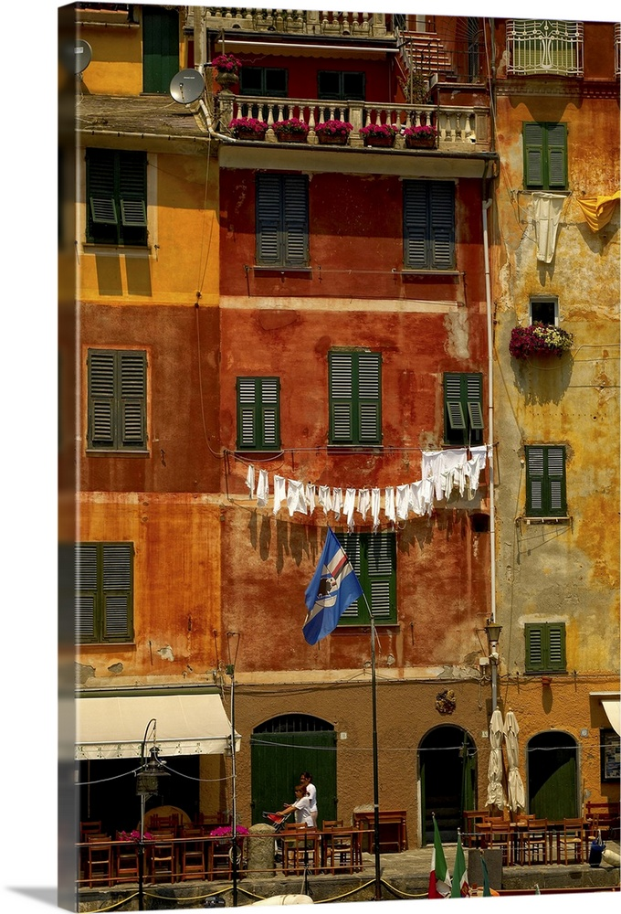 Large Gallery-Wrapped Canvas Wall Art Print 16 x 24 entitled Clothes hanging from the windows Gallery-Wrapped Canvas entitled Clothes hanging from the windows.  Portofino, Liguria, Italy, Europe.  Multiple sizes available.  Primary colors within this image include Orange, Brown, Black, Dark Forest Green.  Made in the USA.  All products come with a 365 day workmanship guarantee.  Archival-quality UV-resistant inks.  Canvases are stretched across a 1.5 inch thick wooden frame with easy-to-mount hanging hardware.  Canvas is designed to prevent fading.